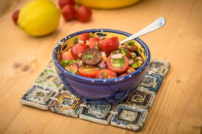 Tomato, chorizo and parsley salad